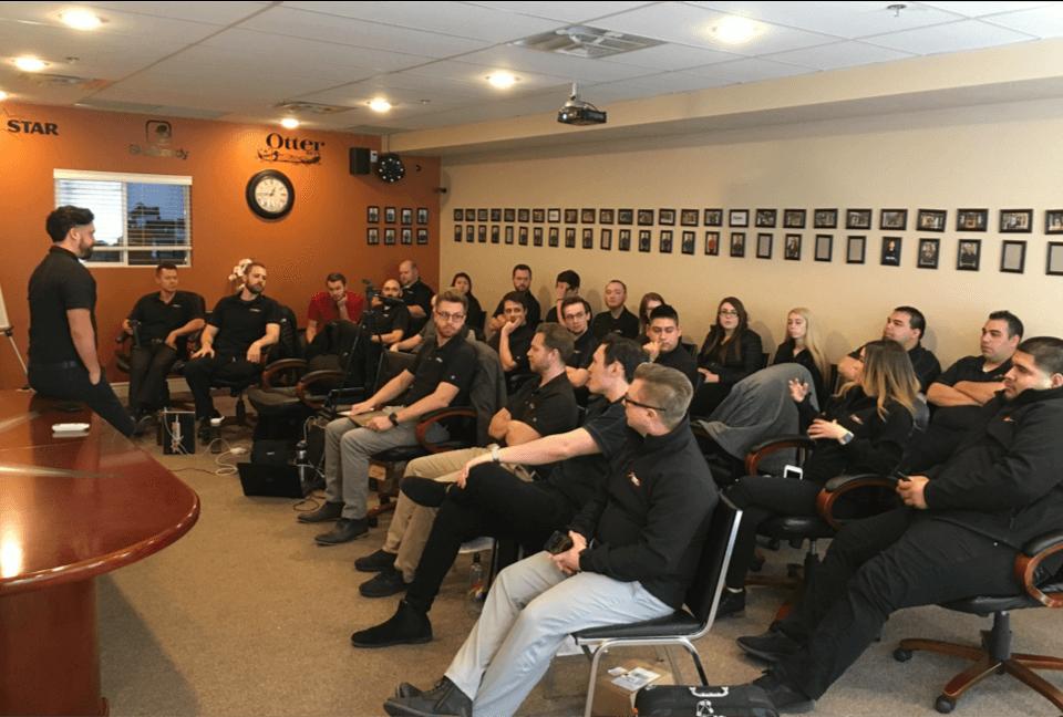 Group of people watching a speaker