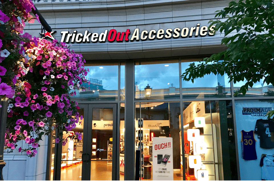 Outside of Tricked Out Accessories store with two trees