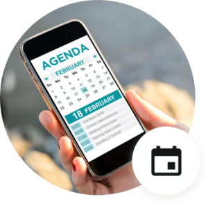 Hand holding phone with word agenda on screen