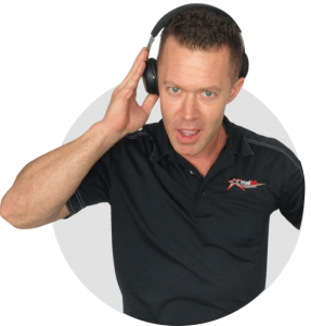 Man holding headphones to ear