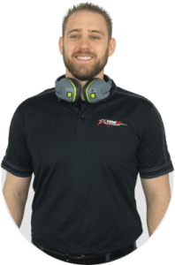 Man in black shirt with headphones around neck