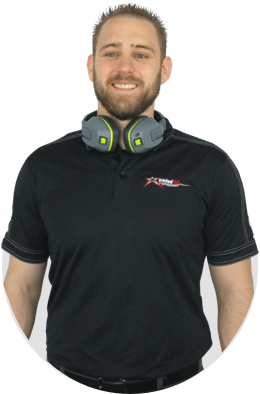 Man in black shirt with headphones around neck