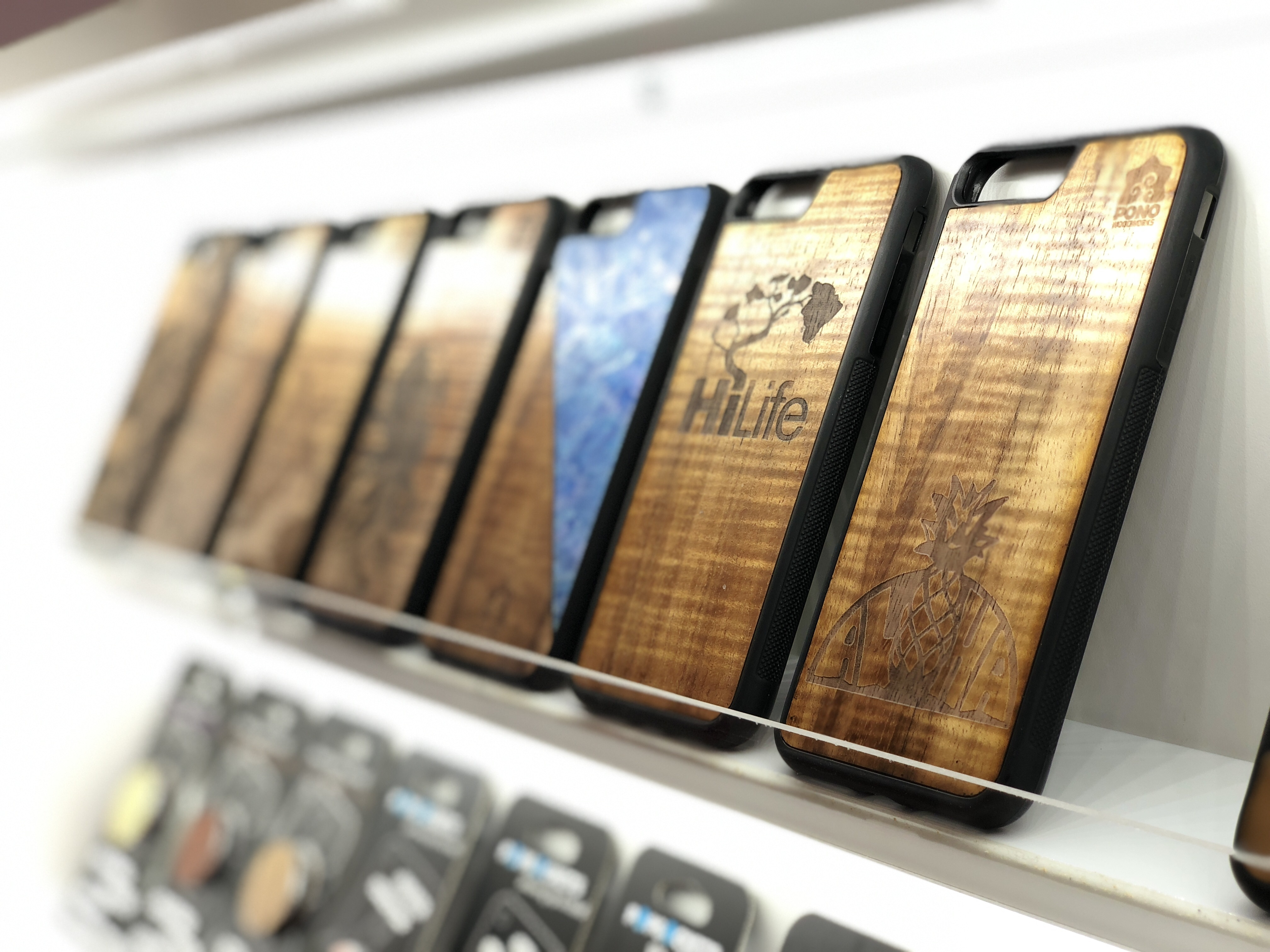 Row of wood phone cases